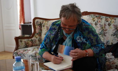 Mrs Amato-Koller signs one of her books.